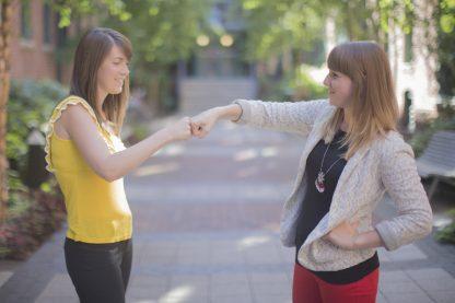 Girls Fist bump