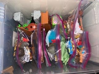 Toys organized using plastic zip-lock bags