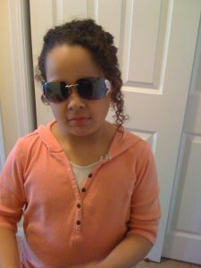 Young girl wearing sunglasses