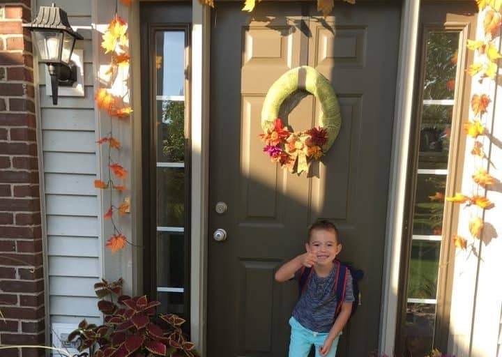 Child ready for school with book bag