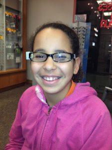 child in prescription glasses