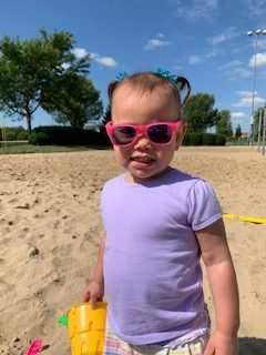 toddler in pink sunglasses