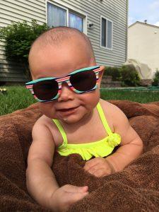 Infant wearing sunglasses