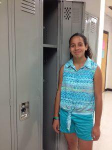 Standing by locker in school