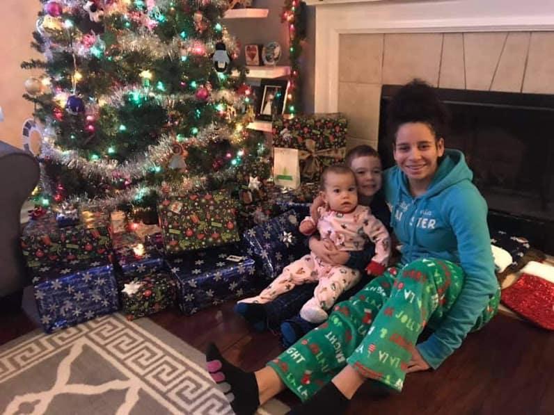 kids around Christmas tree