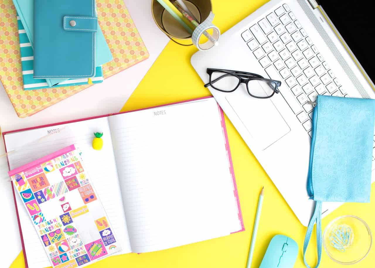 cluttered items on desk