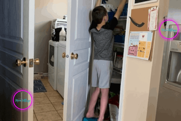 Child getting a snack from the pantry