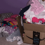 Piles of clothes on the floor