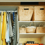 Closet with baskets and hanging clothes